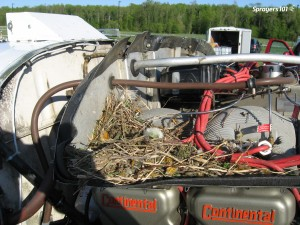 This spray plane was left on the runway with the engine exposed for less than four hours. When the owners returned they found a precocious bird had built a nest. Perform regular sprayer inspections – you never know what you'll find! Photo Credit – S. Richard, New Brunswick.