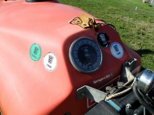 "This used Myers sprayer was imported from Europe by a vineyard in Prince Edward County, Ontario. Many European countries require regular sprayer maintenance inspections before the operator can use them. The stickers on this sprayer show that it was maintained and calibrated correctly. In certain countries, sprayers that are not compliant are ""grounded"" until the issue is remedied, and the owner is charged a hefty fine. We don't require this level of compliance in North America… yet."