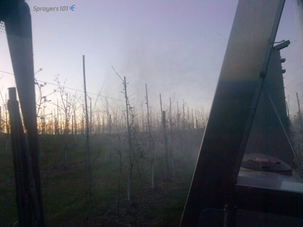 Taken with the sprayer operator's smart phone, here's the over-the-shoulder view of an early-morning spray application from the cab. You can't see coverage, but gaps in the spray will show if nozzles are plugged. You can also check to see if you are overshooting or blowing through the target. Photo Credit – C. Hedges, ON.