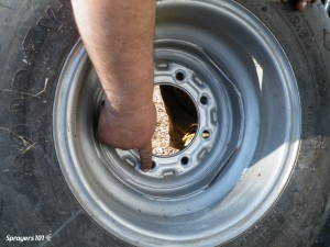Remove the lug nuts and take the wheel off the hub.