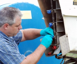 Adjusting the nozzles on a fishtail-style nursery sprayer.