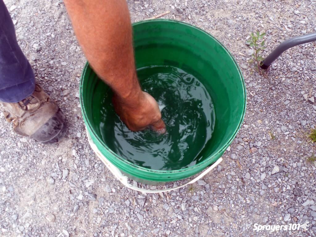 Pre-suspending nematodes before inoculating the spray tank.