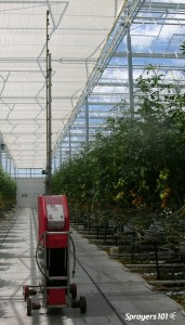 A greenhouse robotic vertical boom sprayer.