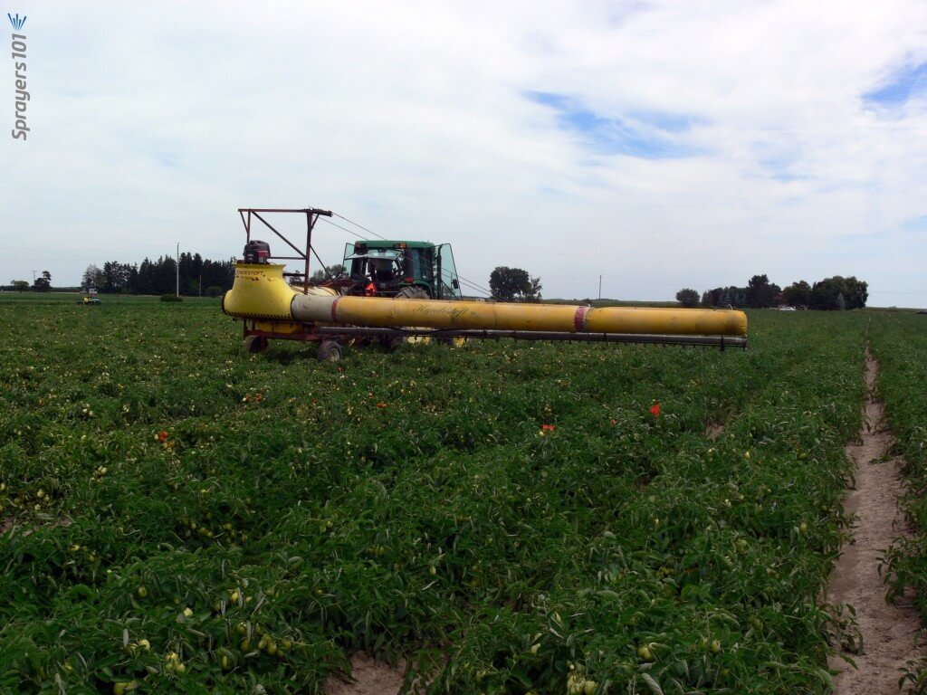 Boom sprayer with air assist sleeve operating.
