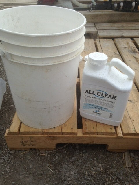 """A pail and detergent are """"must-haves"""" during sprayer cleanup."""