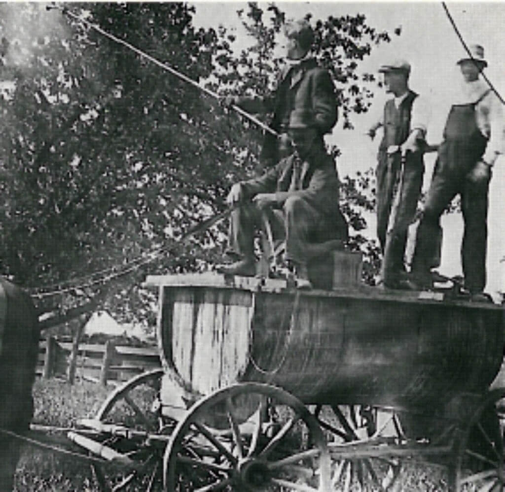 An Ontario orchard spray crew c.1910. Pump pressure was maintained by the two operators at the right. The spraying rate by the above method could cover 1.2 to 1.6 hectares (3 to 4 acres) per hour. Image from www.farms.com